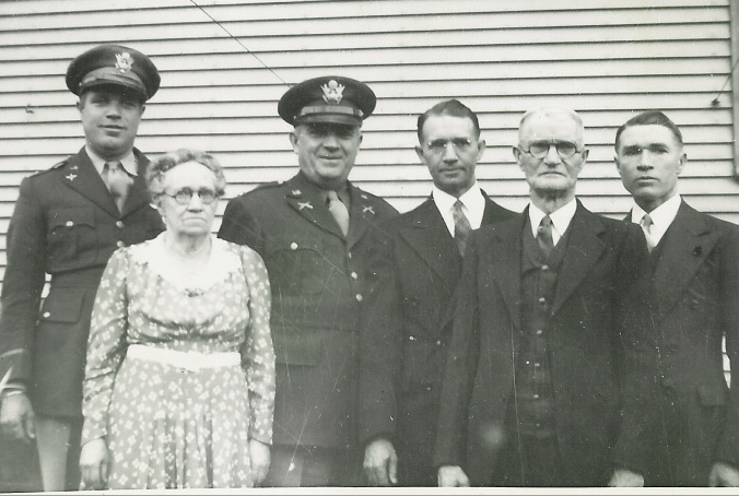 1942. Ralph with his family, possible on leave before leaving for China. Older brothers George, Frank, Harry (my grandpa) and parents Hiram and Violet. (his sister Myrtle died in 1936)