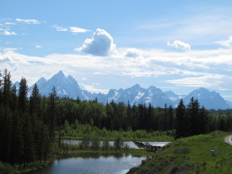 "the Tetons are more than the ""Grand Teton"". It is the tallest of an impressive range of peaks. but a range of many impressive peaks, This is a view at the northern end of the range, driving into the park from the east, the Dubois side, a much quieter side of the park than the Jackson entrance."