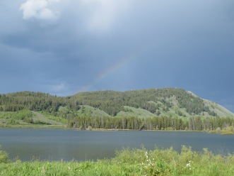 rainbow over Snake River, looking an island in the river where a pair of White Pelicans were hanging out.