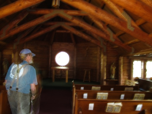 Mike seems to be be givng off quite an aura while enjoying the quiet & coolness of the chapel!