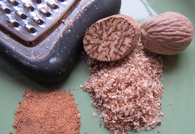 store bought, dried ground nutmeg, and fresh grated nutmeg, showing the beautiful patterns inside the nutmeg fruit.
