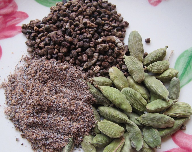 the forms of cardamon, the green, dried pods, the seeds from in side the pods, and fresh ground cardamon.