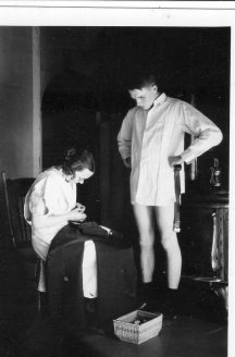 Audrey doing some pants repair for Harry